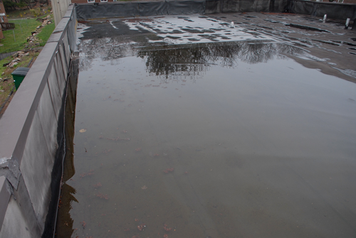Water pooling on a commercial roof, drains are not working