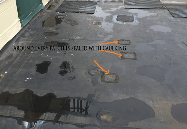 Foot Traffic Repair Patches on an EPDM Roof - the mats are not in the walk areas.