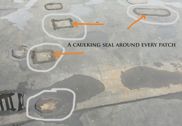 Below is an image of an EPDM single-ply flat roof system that was repaired many times due to faulty adhesives.