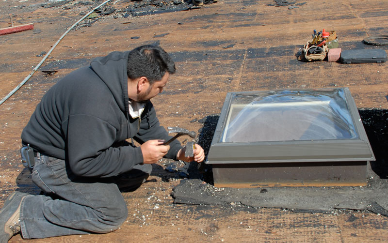 Preparing and cleaning the flashing around a skylight is tedious and labor intensive.