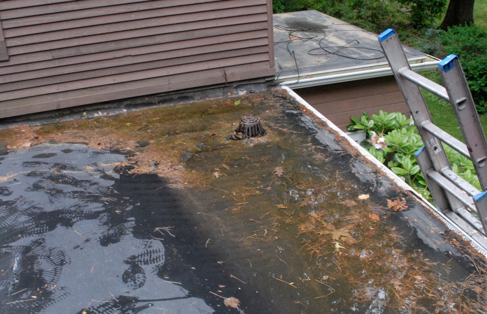 Flat Roof Drains - This drain was installed unnecessarily and too close to the wall.