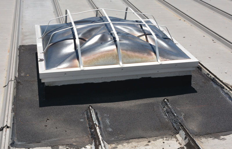 This is what it looks like when a rubber membrane has been installed around a skylight on a metal roof
