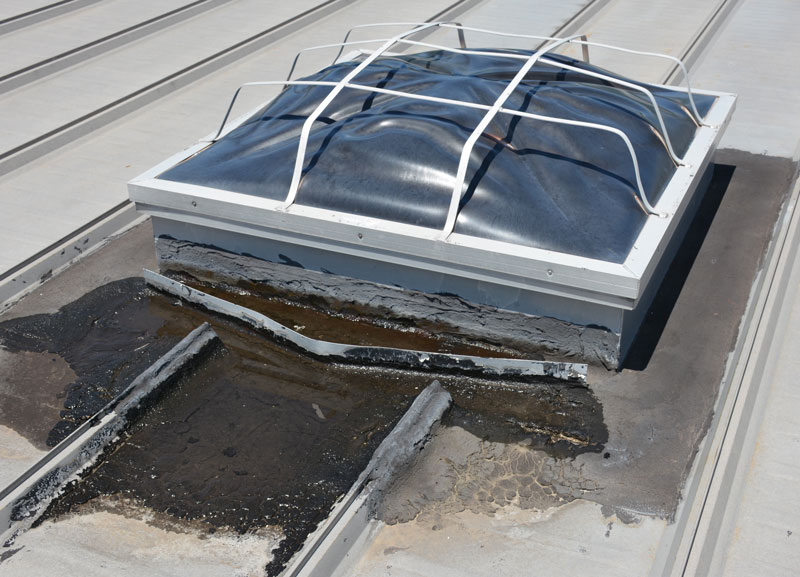 Many contractors and repair men will use tar to fix a leak around a skylight on a metalroof