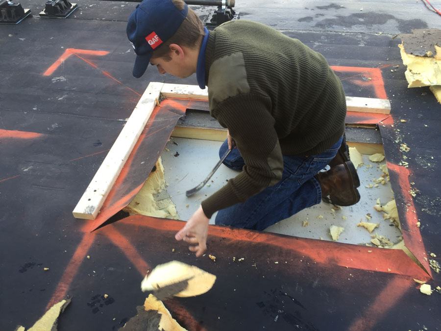 Preparing the roof to cut a hole through the metal