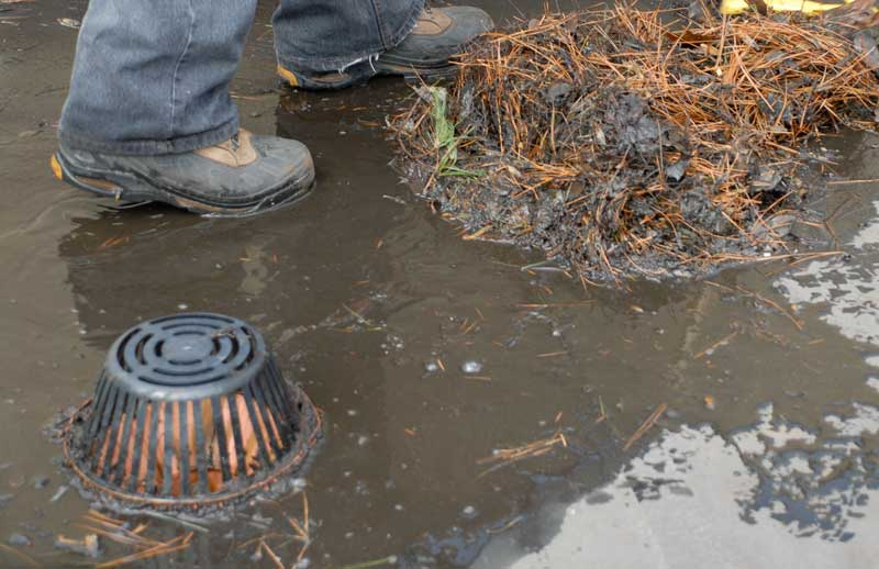 Debris around a strainer and drain will eventually clog drains up