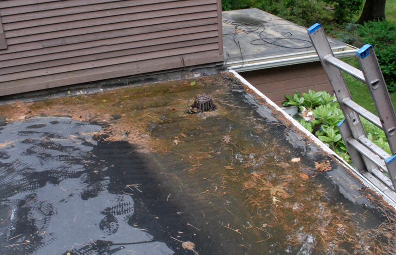 Although the drain is properly located, a drain basin is needed.