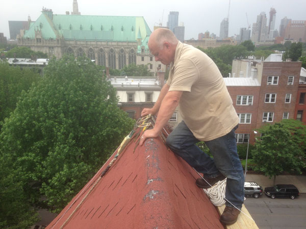 Watching Andre repair flashing on a chimney in Brooklyn, NY.