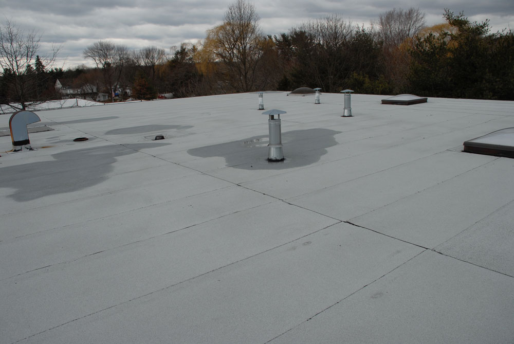 This 2 Ply Modified Bitumen Torch Down Rubber roof has not needed any repairs since its installation over 14 years ago.