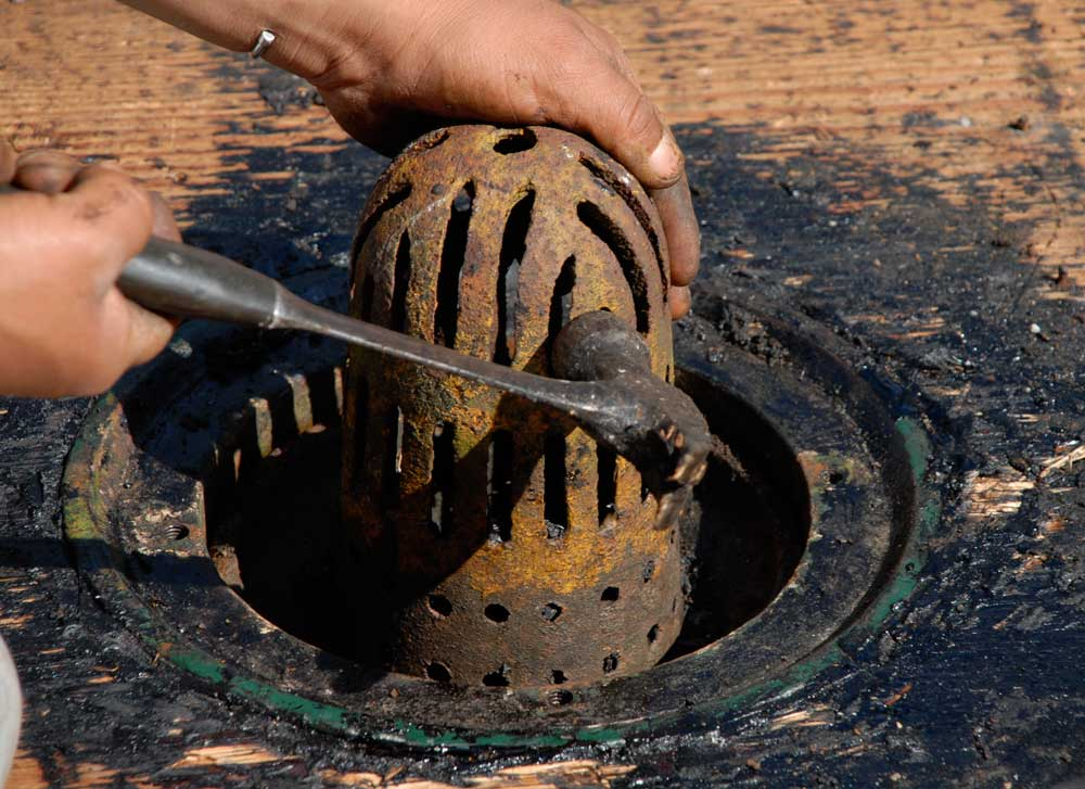 This is a cast iron flat roof drain strainer. This was a badly designed drain strainer due to the small openings